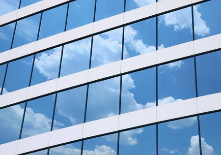 Building windows with Clouds reflection Stock Photo