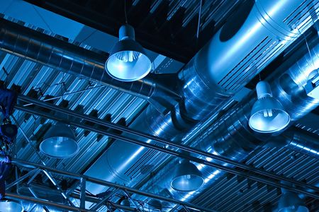 Industrial factory ceiling with ventilation system and lights Stock Photo