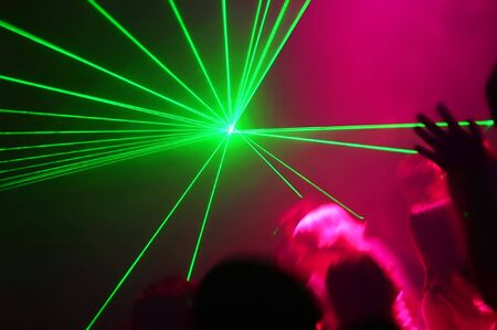 People Dancing at the Disco with laser show Stock Photo - 967441