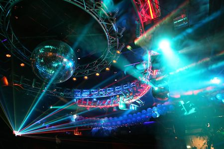 Party at Large Disco with young people and fantastic laser show in smoke