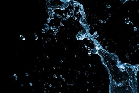 Liquid Water Splash on Black Background Stock Photo