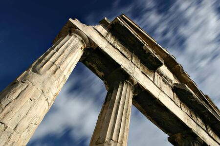 Old Greek columns in Athens - Passing Time Concept