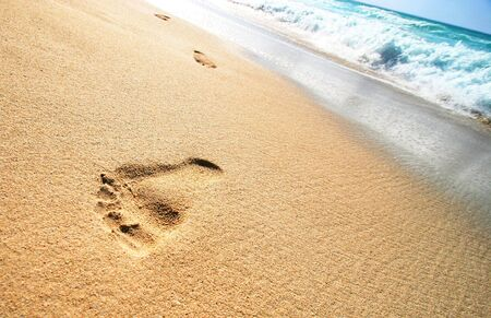 Foot Prints on Tropical Sandy Beach
