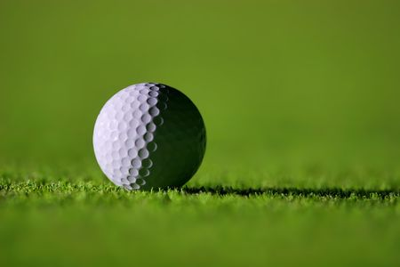Perfect Golf Ball on the Green Grass