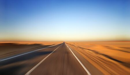 Fast Driving on Desert Highway Stock Photo