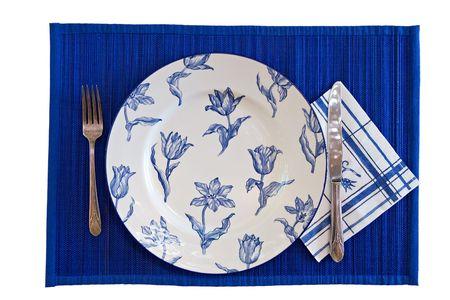 Elegant Blue eating set with silverware on white background photo