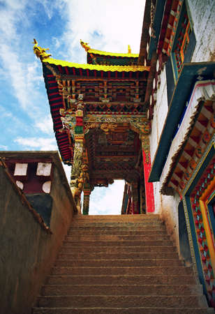 lamaism: A picture of ornamental wooden, beautifully painted gate to a Tibetan buddhist monastery in Xainecheng, Sichuan, China