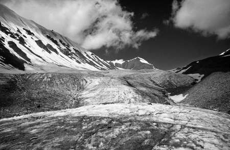 A black and white photo of a high mountain glacier valley in Pamir Mountains in Kyrgystan photo