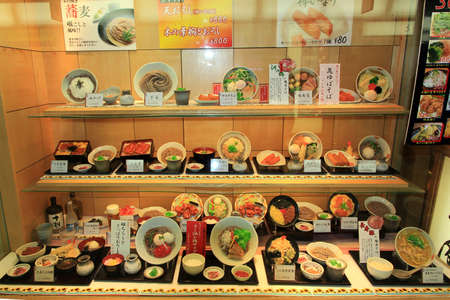 Osaka, Japan - June 17, 2010  Plastic models of various dishes in a restaurant windowon  June 17, 2010  in Osaka, Japan  Most street bars and restaurants in Japan exhibit their menu in the form of plastic models