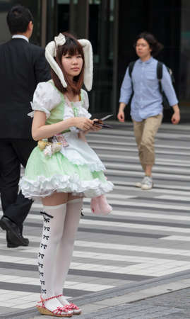 Tokyo, Japan - June 25, 2010  A girl advertising cosplay hostess bar on June 25, 2010 in Tokyo, Japan  Cosplay hostess bars with dressed-up girls are very popular in Tokyo  Redakční