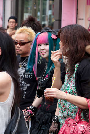 subcultures: Tokyo, Japan - June 2010 - A young subcultural couple standing in the crowd in Harajuku district in June 2010 in Tokyo  Harajuku district is a traditional meeting place for young people in Tokyo  Editorial