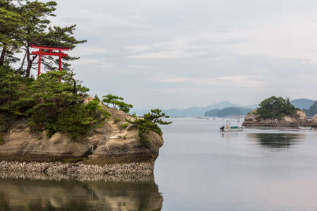 islets: Sea landscape with several islets and a red torii gate in Matsushima, Japan