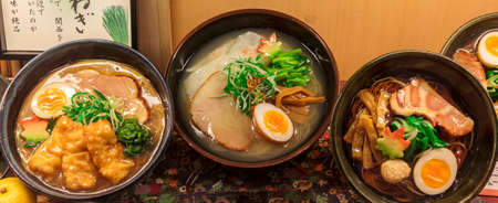 Three different kinds of ramen soup, a traditional japanese dish  photo