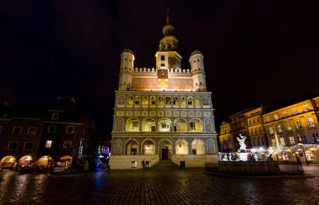 Poznan, Poland - Janurary 10, 2014  Night photo of beautiful historical townhall and surrounding houses on Janurary 10, 2014