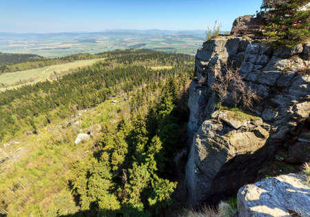 vistas: Spectacular view from top of Strzeliniec Wielki Peak, Poland with vertical rocks and large vistas of space down below  Stock Photo