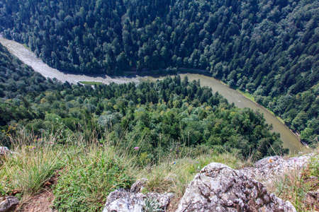windings: spectacular river canyon in Pieniny, Poland viewed from Sokolica peakwith vertical rocks and river and forest down below  Stock Photo