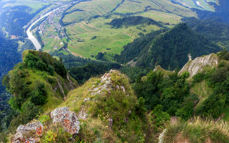 windings: Breathtaking view from Three Crown Mountain, Pieniny, Poland with large vistas of space down below   peaks, forest, meadows, fields and villages