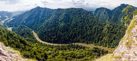 windings: Panoramic photo of spectacular river canyon in Pieniny, Poland  Winding Dunajec surrounded by mountain slopes covered with forest