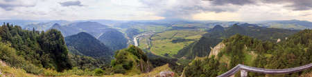 Panoramic photo of Pieniny Mountains, Poland with large vistas of space down below   peaks, forest, meadows, fields and villages  photo