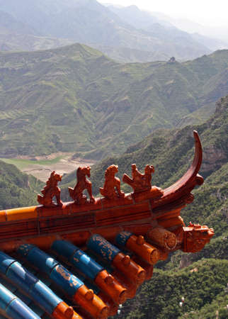 bass relief: Qilin and dragon figurines adorn the roof of a taoist Taoist temple in North China, near Datong, Shanxi Province  Heng Shan is ont of the most important Taoist mountains in China