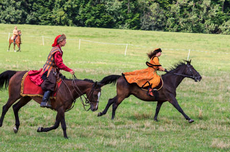 17th: Oblegorek, Poland - July 15, 2012  History fans dressed as 17th century Polish gentry ride on horseback at a free public reenactment show in Oblegorek on July 15, 2012