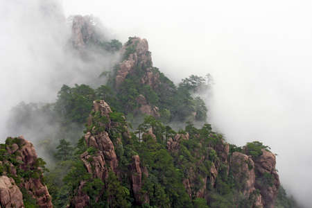 huang: Generic chinese landscape - mist rising over Huang Shan  Yellow Mountains  Stock Photo