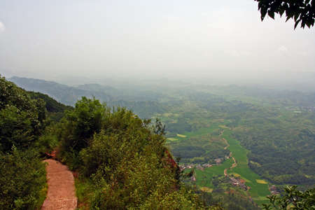 vistas: Generic chinese landscape - pathway on top of Qiyun mountain with large vistas of green countryside in the distance Stock Photo