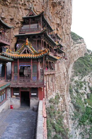 bejing: Heng Shan, China - July 21, 2009  Famous hanging monastery in Shanxi Province near Datong, China, viewed from the side on July 21, 2009  Hanging monastery is one of the greatest architectural marvels in China  Editorial