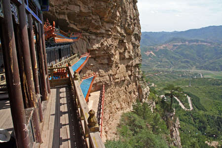 north china: A Taoist temple carved in rock with large vistas of space below in North China, near Datong, Shanxi Province