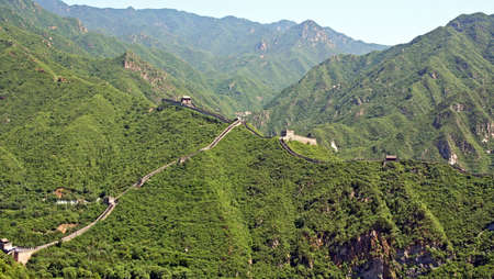 A fragment  of restored Ming dynasty fortress at Juyongguan, north of Beijing against the of green mountains photo