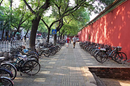 Beijing, China - August 02, 2009  Rows of bicycles parked along the walls of Forbiden Palace complex on August 02, 2009