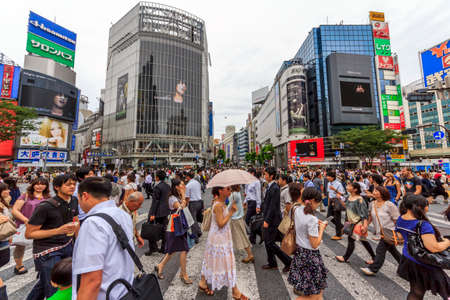 Tokyo, Japan - June 26, 2010  Wideangle photo of the crowds of people at Shibuya Crossing on a cloudy day on 26 June 2010  Shibuya is probably the best known meeting place in Tokyo