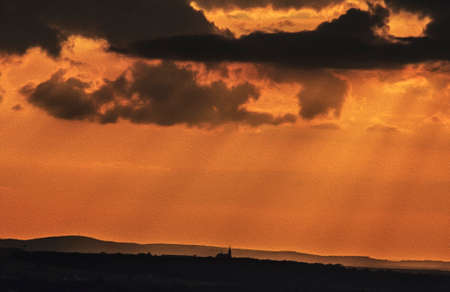 spectacular: A picture of small church silhouette against spectacular orange sunset sky, stylized and filtered to look like an oil painting