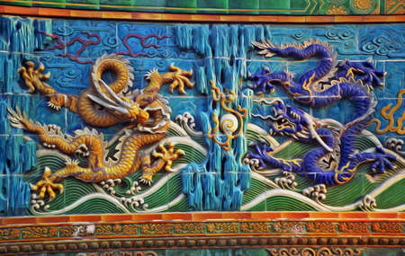 bas relief: bas-reliefs of traditional chinese dragons with pearls, stylized and filtered to look like an oil painting  Stock Photo