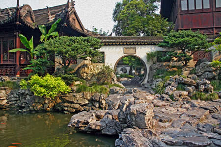 moon gate: Photo of  Yuyuan garden in Shanghai with moon gate, pavilions and rocks, stylized and filtered to resemble an oil painting