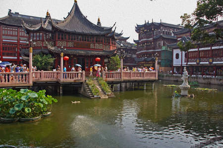 garden fountain: old city in Shanghai with restored houses and a pond, stylized and filtered to resemble an oil painting  Stock Photo