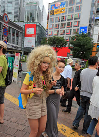 subcultures: Tokyo, Japan - June 26, 2010 - Blond gothic lolita at the Shibuya crossing on June 26, 2010  Shibuya district is a traditional meeting place for young people in Tokyo