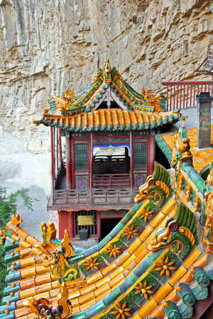 bejing: Ornamental, beautifully painted roofs of the famous hanging monastery near Datong, China, viewed from the side