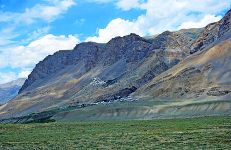 Generic himalayan landscape, with mountains, tibetan monastery and river canyon, stylized and filtered to resemble an oil painting  Location   Dhankar village,  Spiti valley, India  Stock Photo