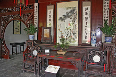 photo of a classical chinese interior in a pavilion at a garden in Suzhou