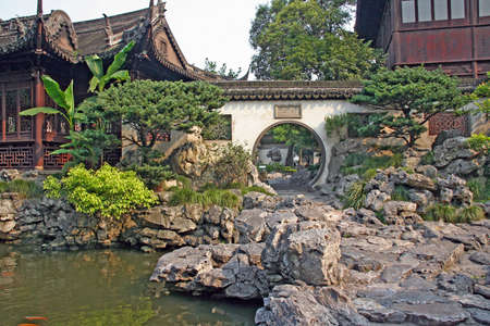 moon gate: Photo of a fragment of a pavilion and pond in Yuyuan gardens, Shanghai