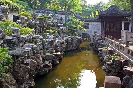 moon gate: Photo of  Yuyuan garden with a pond and a classic chinese stone garden