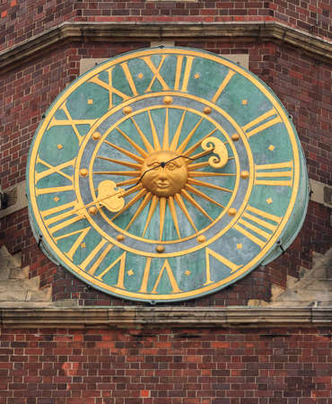 Close up photo of  an old clock on the main tower of the city hall, Wroclaw, Poland photo