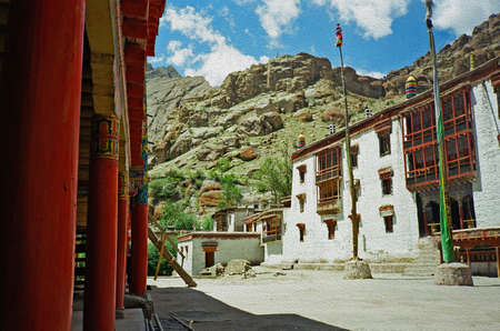 lamaist monastery in ladakh, India stylized and filtered to look like an oil painting. In background mountains and blue sky photo