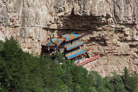 taoist: hengshan taoist monastery in Shanxi Province near Datong, China, stylized and filtered to resemble an oil painting.