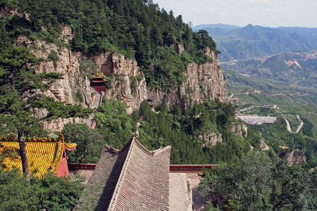 taoist: hengshan taoist monastery in Shanxi Province near Datong with landscape in background, China, stylized and filtered to resemble an oil painting.