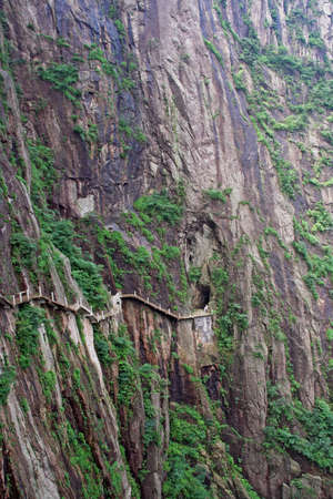 anhui: The pathway made on the vertical slope of a mountain, Huang Shan (Yellow Mountains), China, stylized and filtered to look like an oil painting.