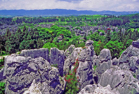 kunming: aerial view of shilin - stone forest - near Kunming in Yunnan province, china, filtered and stylized to resemble an oil painting