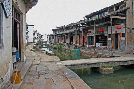 photo of a canal in ancient village in Anhui province, china, stylized and filtered to resemble an oil painting. photo