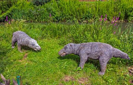 prehistoric animals: Baltow, Poland - June 12, 2014: Realistic models of prehistoric mammals in Jura Park, Baltow on June 12, 2014. Jura Park in Baltow exihibits numerous natural size extinct animals models. Editorial